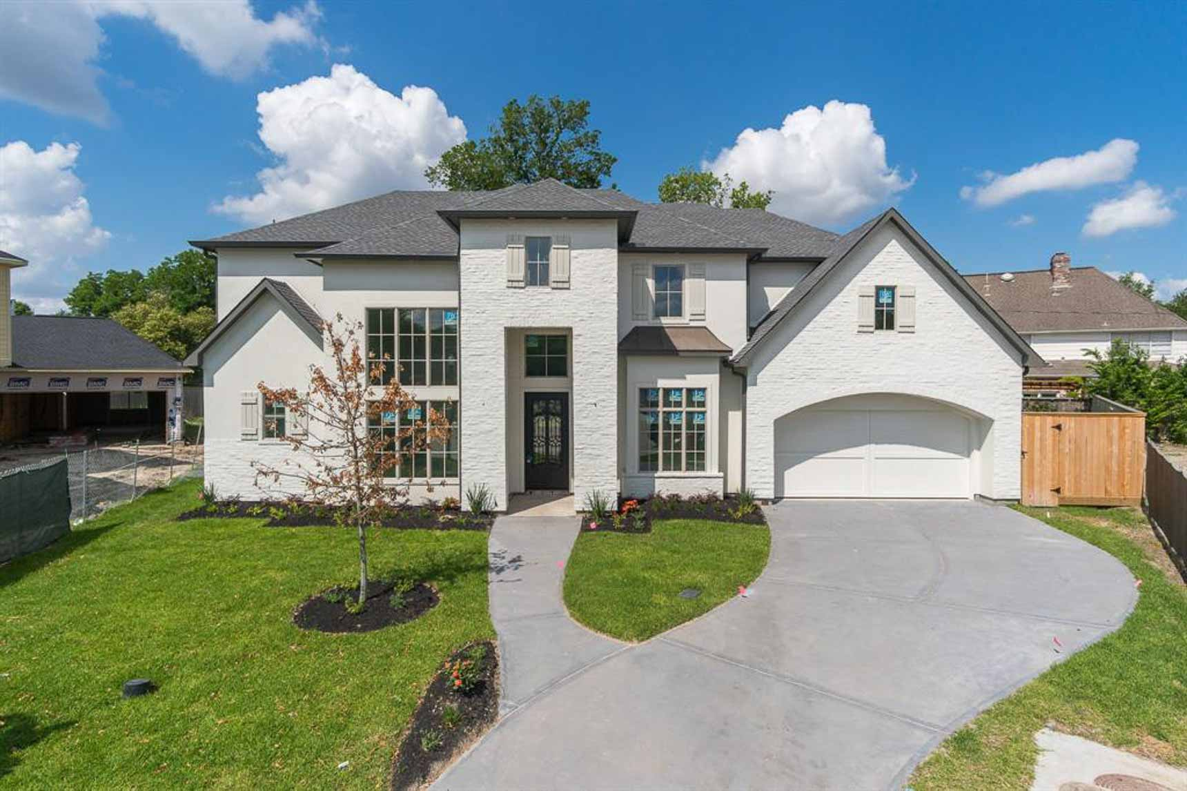 White painted brick home on a nearly 14,000 square foot lot.